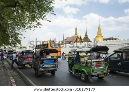 BANGKOK, THAILAND - JULY 11, 2015: Tourists visit the Grand Palace in Bangkok, Grand Palace in Bangkok  ( This is an important buddhist temple of Thailand and a famous tourist destination.) - stock photo