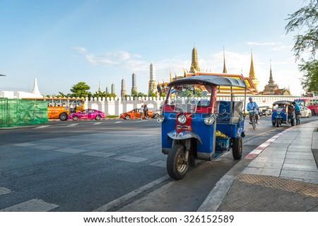 BANGKOK, THAILAND - JULY 11, 2015: Tuk tuk for passenger cars. To go sightseeing around the Grand Palace in Bangkok , Thailand. Grand Palace is the most famous temple and landmark of Thailand. - stock photo