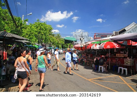 BANGKOK, THAILAND - JULY 05, 2014: Unidentified foreign people shopping at Chatuchak weekend market open from 8am - 6pm. Here is the largest weekend market in Thailand.