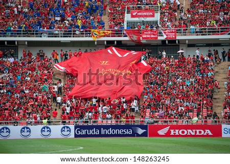 BANGKOK, THAILAND - JULY 28: Unidentified Thai fan Liverpool FC supporters during the international friendly match Thailand and Liverpool at Rajamangala Stadium on July 28, 2013 in Bangkok,Thailand.  - stock photo