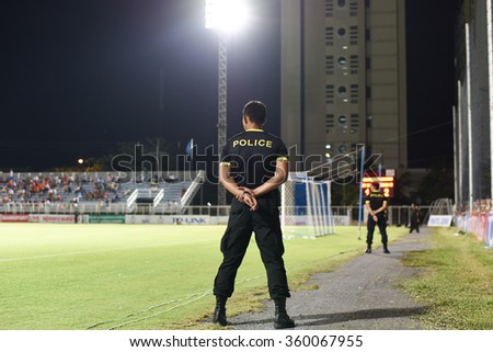 BANGKOK,THAILAND-JUN 28 : Security police in action during the competition 2015 Thai premier league between TOT SC vs Suphanburi fc at tot stadium on June 28,2015 - stock photo