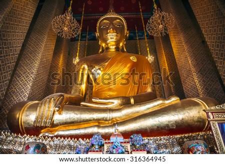 Bangkok, Thailand - Junary 1, 2014: Big golden buddha image inside the hall of Wat Kalayanamitr, Bangkok, Thailand  - stock photo