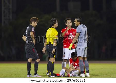 BANGKOK,THAILAND:JUNE 2015:Adisak of BEC-Tero Injured;BEC-Tero Sasana(red)-SCG Muangthong United(Back) at 72nd Anniversary Stadium;inThai Premier League on18July2015,Bangkok Thailand. - stock photo