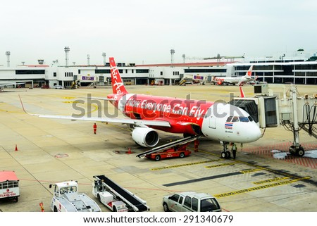 Bangkok Thailand - June 23, 2015: Airliner Air-Asia maintenance checking during refueling and loading baggage at Don mueang airport, Bangkok Airplane - stock photo