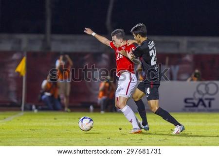 BANGKOK,THAILAND:JUNE 2015:(FW)Tristan Somchai Do No.19;BEC-Tero Sasana(RED)-SCG Muangthong United(BACK)at72nd Anniversary Stadium;inThai Premier League on18July2015,Bangkok Thailand.  - stock photo