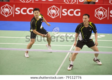 BANGKOK THAILAND- JUNE 11 : Howard Bach and Tony Gunawan in action in the Final rounds of SCG Thailand Open Grand Prix Gold 2011 on June 11, 2011 in Bangkok ,Thailand - stock photo
