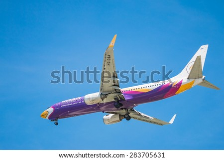 BANGKOK, THAILAND - JUNE 1, 2015: HS-DBA Nok Air Boeing 737-800 landing to Don Mueang International Airport Thailand. Nok Air company is the largest low cost airlines in Thailand.
