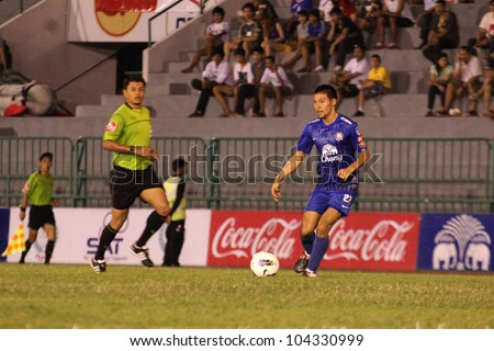 BANGKOK THAILAND - JUNE 3 : Kazuto Kushida (B) in action during Thai Premier League (TPL) Insee Polise United (red) VS Chonburi FC (Blue) at Army Stadium on June 3,2012 in Bangkok,