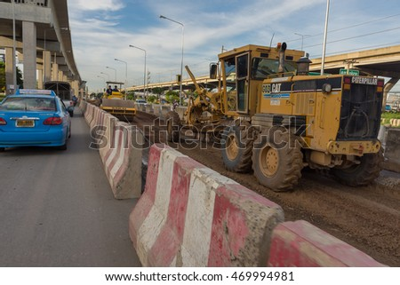 Bangkok, Thailand - June 3, 2016 : Motorgrader working at Construction site of sky train redline from Bangsue to Rangsit is a big infrastructure for transportation in Bangkok Thailand.