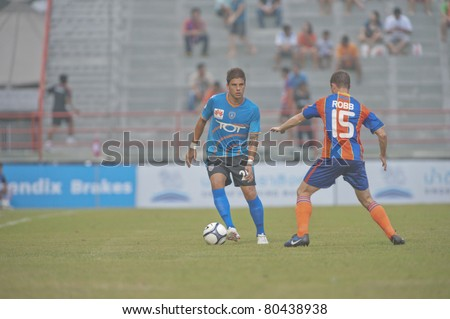 BANGKOK THAILAND- JUNE 29 : N.Jerreny (L) in action during Thai Premier League (TPL) between thai port fc (Orange) vs TOT SC (Blue) on June 29, 2011 at PAT Stadium in Bangkok Thailand
