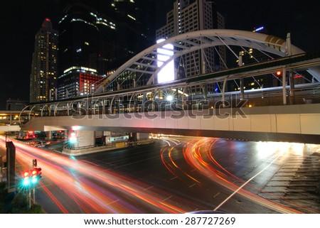 BANGKOK, THAILAND -JUNE 8, 2015 : Night light at Chong Nonsi skywalk for transit between sky train on JUNE 8, 2015 in Bangkok , Thailand. - stock photo