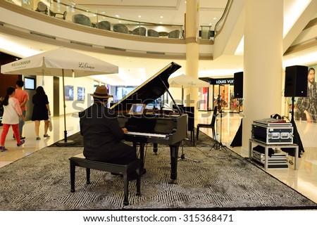 BANGKOK, THAILAND - JUNE 21, 2015: shopping center interior. Shopping centres such as Siam Paragon, Central World Plaza, Emperium, Gaysorn and Central Chidlom become shopping Mecca for shopaholics - stock photo