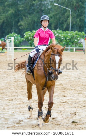 BANGKOK, THAILAND - JUNE 22: Unidentified Equestrian with horse at MaxWin Show Jumping League & Horse Guard 2014  on June 22, 2014 in Royal Horse Guard MaxWin Riding Arena Bangkok, Thailand. - stock photo