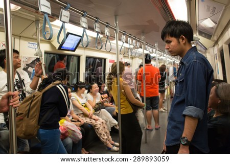 BANGKOK, THAILAND - JUNE 6 : Unidentified passengers in MRT Subway on June 6, 2015 in Bangkok, Thailand. It is an elevated rapid transit system in Bangkok, Thailand. - stock photo