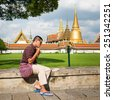 BANGKOK, THAILAND - JUNE 8 : Unidentified tourists travel to Wat Phra Kaew and Grand Palace on June 8, 2013 in Bangkok, Thailand. Wat Phra Kaew is the most popular place for tourists to visit  - stock photo