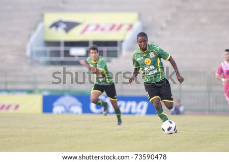 BANGKOK THAILAND - MAR 19: R.Santana(G) in Thai Premier League (TPL) between Army Utd. (green) vs Sisaket Mungthail Fc (pring) on March 19, 2011 at Army Stadium in Bangkok Thailand