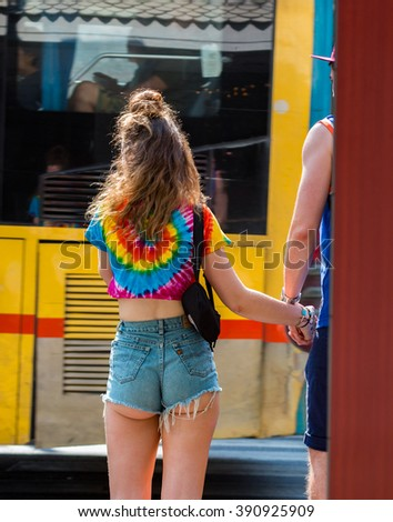 Bangkok, Thailand - Mar 13, 2016 : Tourist, The girl in hot pants and her friend walking hand in hand along the way, Then stop and wait to cross the road. - stock photo