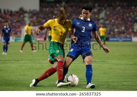 BANGKOK,THAILAND-MARCH 30:Clinton Njie (L) of Cameroon in action during the international friendly match between Thailand and Cameroon at Rajamangala Stadium on March30 2015 in,Thailand.