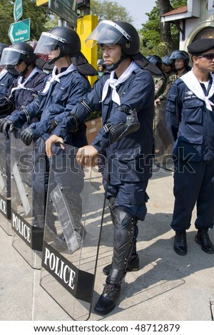 BANGKOK , THAILAND - MARCH 13: Closeup of a police protecting government buildings during anti government Solidarity demonstration on March 13, 2010 in Bangkok, Thailand.