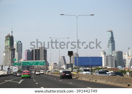 Bangkok, Thailand - March 14, 2016: Elevated road vehicles with Bangkok Skyline(Tallest Building ) at Noon,modern city and traffic. - stock photo