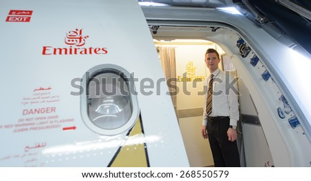 BANGKOK, THAILAND - MARCH 31, 2015: Emirates A380 crew member meet passengers. Emirates is one of two flag carriers of the United Arab Emirates along with Etihad Airways and is based in Dubai. - stock photo
