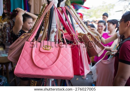 BANGKOK, THAILAND - MARCH 15 : Fake handbags on display at Jatujak or Chatuchak Market on March 15, 2015 in Bangkok, Thailand. Jatujak Market is the largest market in Thailand. - stock photo