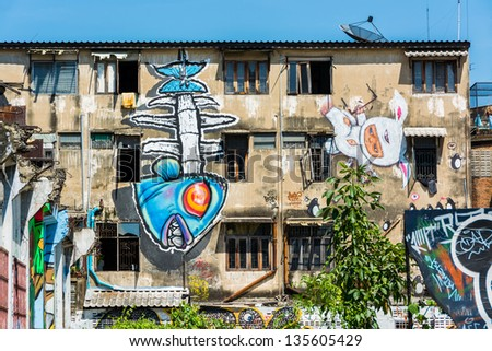 BANGKOK, THAILAND - 20 MARCH : Giant graffiti on abandon building of Bangkok on March 20, 2013. The building is leftover - stock photo