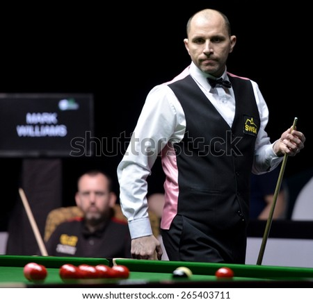 BANGKOK,THAILAND-MARCH 28: Joe Perry of UK in action against Mark Williams of Wales on final round the Players Championship at Montien Riverside Hotel, Bangkok on March 28,2015 in Bangkok,Thailand