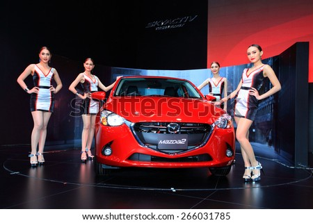 BANGKOK, THAILAND - MARCH 24 : The new Mazda 2 and super models displayed on stage at the 36th Bangkok International Motor show  in March 24, 2015. Bangkok, Thailand - stock photo