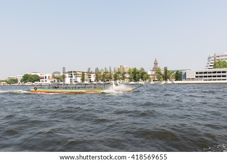 Bangkok, Thailand - March 6, 2016 : Tourist popular boat travel on the Chao Phraya river. To stay in downtown Bangkok. And tourist attractions on both sides of the river.