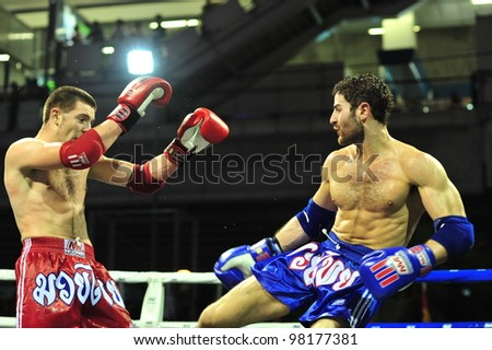 BANGKOK, THAILAND- MARCH 21 : Unidentified athletes compete in World Amateur Muaythai Champioships 2012. on March 21, 2012 at National Stadium, Bangkok, Thailand