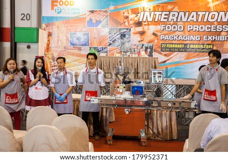 BANGKOK, THAILAND - MARCH 1:Unidentified chef show how to use a new kitchenware made a food.MARCH 1,2014  in Bangkok,Thailand. - stock photo