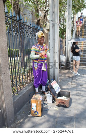 BANGKOK, THAILAND - MARCH 15 : Unidentified man sings Manora Song as a street show at Jatujak Market on March 15, 2015 in Bangkok, Thailand. Jatujak Market is the largest market in Thailand. - stock photo