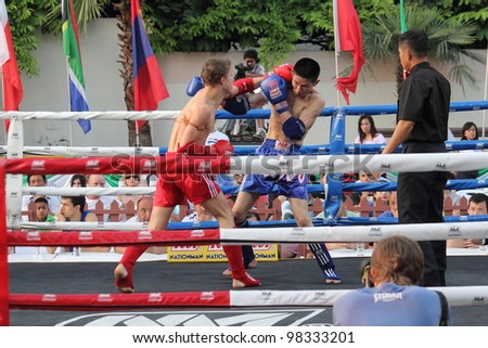 BANGKOK, THAILAND- MARCH 22 : unidentified Muay Thai fighter in World Amateur Muaythai Champioships 2012. on March 22, 2012 at National Stadium, Bangkok, Thailand - stock photo