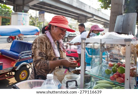 BANGKOK, THAILAND - MARCH 15 : Unidentified papaya salad seller on March 15, 2015 in Bangkok, Thailand. Papaya salad is one of most famous street food in Thailand. - stock photo