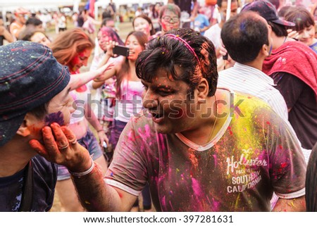 BANGKOK, THAILAND - March 2016: Unidentified People celebrating during the color throw at the Holi Festival of Colors on March 27, 2016 in Bangkok, Thailand.