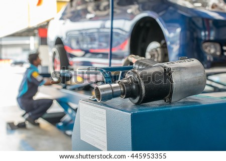 Bangkok, Thailand - March 20, 2016 : Unidentified serviceman checking suspension in a car at garage