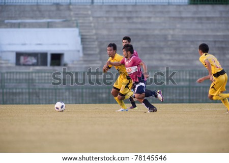 BANGKOK THAILAND- MAY 28 : A.Sington (pink) in action during Thai Premier League (TPL) Divition 1 between BB-CU Fc (P) vs Cat Today Janburi (Y) on May 28, 2011 at Army Stadium in Bangkok Thailand
