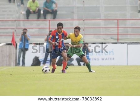 BANGKOK THAILAND- MAY 25 : A.Sumre (red) in action during Thai Premier League (TPL) between thai port fc (Orange) vs TTM Pijit (yellow)   on Msy 25, 2011 at PAT Stadium in Bangkok Thailand