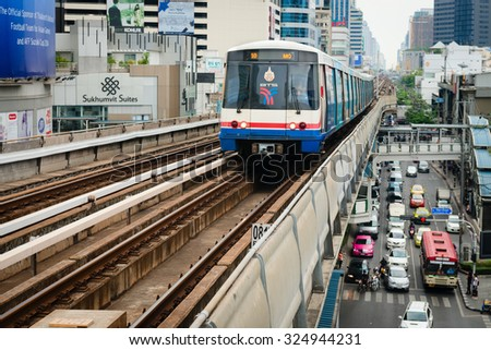 BANGKOK, THAILAND - 07 MAY 2014: BTS metro Skytrain runs through the city center above cars at roads. BTS or the Skytrain is an elevated rapid transport system in Bangkok, Thailand.  - stock photo