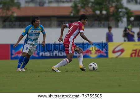 BANGKOK, THAILAND- MAY 7: C.Sanguandee (red) in action during Thai Premier League (TPL) between BEC Tero Fc (Red) vs Pataya Utd. (Blue) on May 7, 2011 at thebhussadin Stadium in Bangkok, Thailand