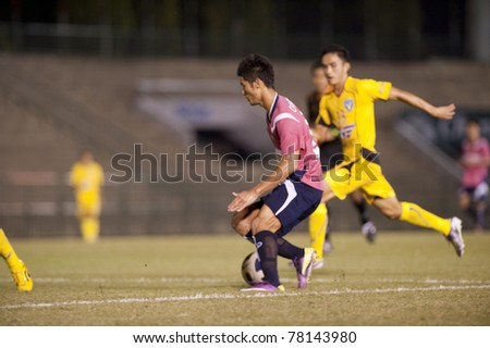 BANGKOK THAILAND- MAY 28 : C.Tatong (L) in action during Thai Premier League (TPL) Divition 1 between BB-CU Fc (P) vs Cat Today Janburi (Y) on May 28, 2011 at Army Stadium in Bangkok Thailand