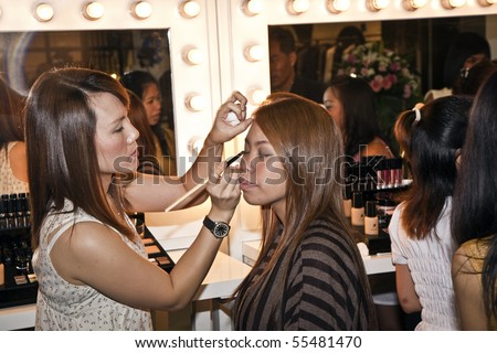 BANGKOK, THAILAND - May 11: cosmetic company AMWAY sponsored a makeup course with its products in the central world center and assists woman in using products , May 11, 2009 in Bangkok, Thailand