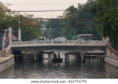 Bangkok, Thailand - May 16, 2016 : Garbage collection boat working in Khlong Phadung Krungkasem is a important canal in downtown Bangkok, Thailand.