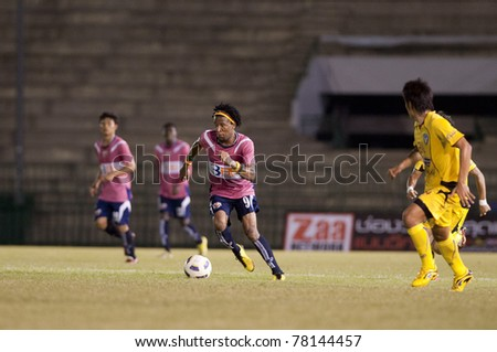 BANGKOK, THAILAND- MAY 28: J.Prince (L) in action during Thai Premier League (TPL) Divition 1 between BB-CU Fc (P) vs Cat Today Janburi (Y) on May 28, 2011 at Army Stadium in Bangkok, Thailand