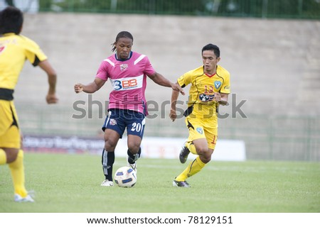 BANGKOK, THAILAND- MAY 28: J.Prince (pink) in action during Thai Premier League (TPL) Divition 1 between BB-CU Fc (P) vs Cat Today Janburi (Y) on May 28, 2011 at Army Stadium in Bangkok, Thailand