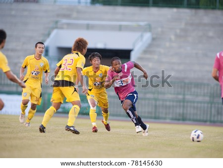 BANGKOK THAILAND- MAY 28 : J.Prince (pink) in action during Thai Premier League (TPL) Divition 1 between BB-CU Fc (P) vs Cat Today Janburi (Y) on May 28, 2011 at Army Stadium in Bangkok Thailand
