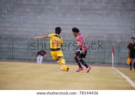 BANGKOK, THAILAND- MAY 28: J.Prince (R) in action during Thai Premier League (TPL) Divition 1 between BB-CU Fc (P) vs Cat Today Janburi (Y) on May 28, 2011 at Army Stadium in Bangkok, Thailand