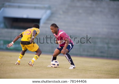 BANGKOK, THAILAND- MAY 28: M.Ndape (R) in action during Thai Premier League (TPL) Divition 1 between BB-CU Fc (P) vs Cat Today Janburi (Y) on May 28, 2011 at Army Stadium in Bangkok, Thailand