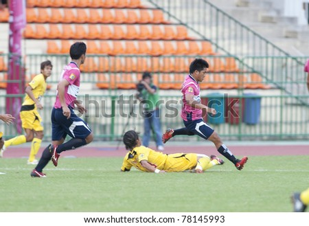 BANGKOK THAILAND- MAY 28 : M.Ndape (R) in action during Thai Premier League (TPL) Divition 1 between BB-CU Fc (P) vs Cat Today Janburi (Y) on May 28, 2011 at Army Stadium in Bangkok Thailand
